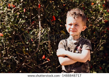 Bad-tempered crying little boy visible tears on face Foto stock ©