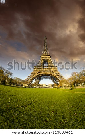 Bad Weather approaching Eiffel Tower in Paris - stock photo