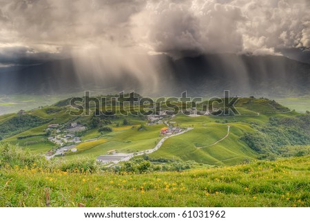 Bad weather landscape of countryside with rain on hills in farm.
