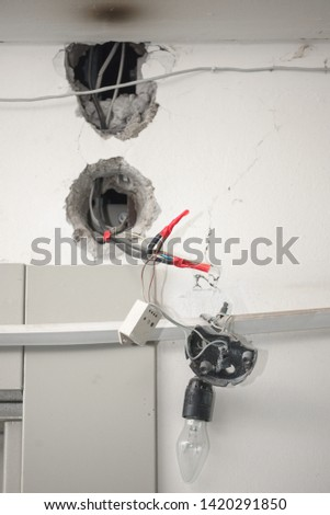 bad wiring. electrical wires protrude from the wall. lamp voltage #1420291850