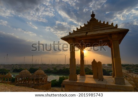 Bada Bagh or Barabagh, means Big Garden,is a garden complex in Jaisalmer, Rajasthan, India, for Royal cenotaphs of Maharajas or Kings of Jaisalmer state. Tourist attraction. Setting sun in background. Zdjęcia stock ©