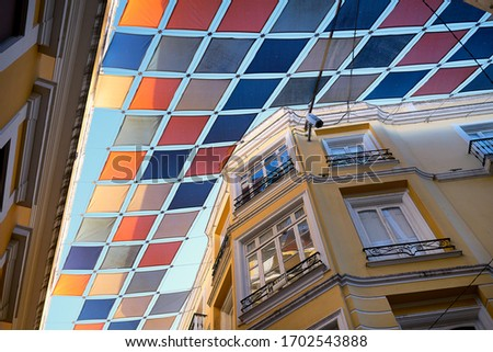 Badajoz street yellow buildings with beautiful colorful square flags, in Spain