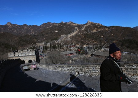 BADALING, CHINA - CIRCA JANUARY 2013. Man walking on the Great Wall of China in Badaling near Beijing on January 2013. The Great Wall of China is the longest man-made structure in the world.