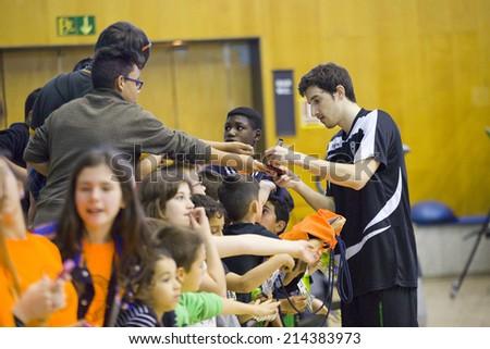 BADALONA, SPAIN - APRIL 13: Guillem Vives of Joventut signing autographs at Spanish Basketball League match between Joventut and Zaragoza, final score 82-57, on April 13, 2014, in Badalona, Spain.