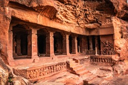 badami cave no one chalukya dynasty ancient stone art from flat angle image is taken at badami karnataka india. it is unesco heritage site and place of amazing chalukya dynasty sotne art.