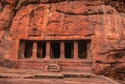 badami cave no two chalukya dynasty ancient stone art from flat angle image is taken at badami karnataka india. it is unesco heritage site and place of amazing chalukya dynasty sotne art.