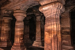 badami cave temple interior pillars stone art in details image is taken at badami karnataka india. it is unesco heritage site and place of amazing chalukya dynasty sotne art.