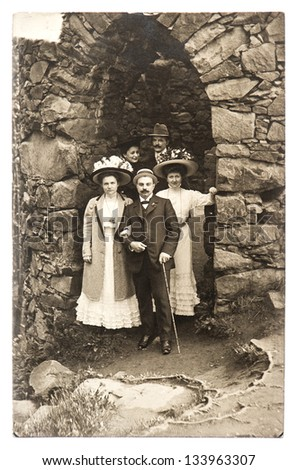 BADEN-BADEN, GERMANY - CIRCA 1915: group of wealthy high society men and women in old castle, circa 1915 in Baden-Baden, Germany