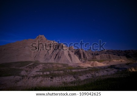Badlands at Night. South Dakotas Badlands National Park at Night. Clear Sky with Many Stars. Nature Photo Collection.