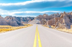 Badlands Loop Road in Badlands National Park in South Dakota, USA. Cloudy Blue Sky - Summer Day