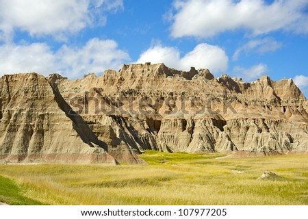 Badlands Prairie Landscape. Summer Cloudy Day in the Badlands NP, SD, USA. US National Parks Photo Collection