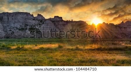 Badlands Prairie Sunrise - sun rises over ridges and grasslands of the Badlands in South Dakota