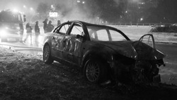 Badly damaged car at the scene of a collision. Black and white. High quality photo