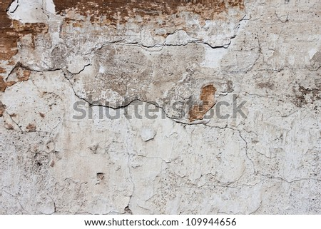 Badly damaged plaster wall background