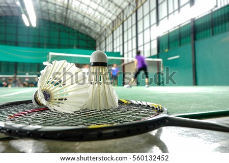 Badminton courts with badminton ball in competition