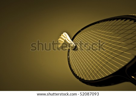 Badminton racket and shuttlecock close-up and action with copy space.