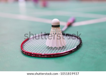 badminton racket and shuttlecock in badminton court.