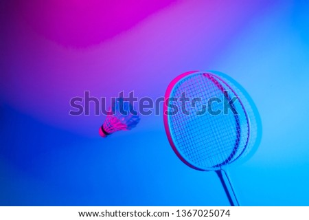 Badminton racket and shuttlecock in vibrant bold gradient holographic neon colors  #1367025074