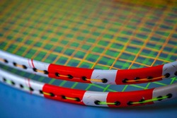 badminton rackets with taut strings close up