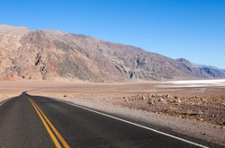 Badwater Road disappearing into barren Death Valley.