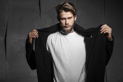 Baerded man in white t-shirt on grey background