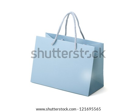 Bag as a gift. Paper bag on white background. Close Up.