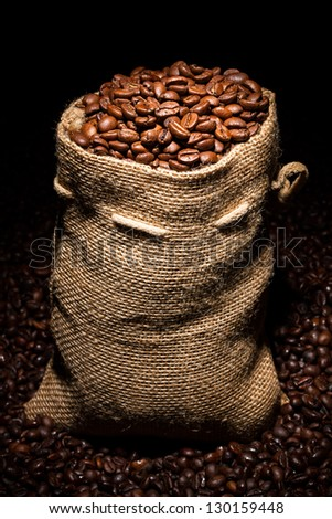 bag filled with coffee beans in spotlight