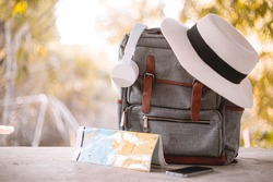 Bag, hat, map and headphones On vacation