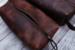 Bag made of genuine brown leather, close-up, top view. Genuine leather products for women and men, accessories