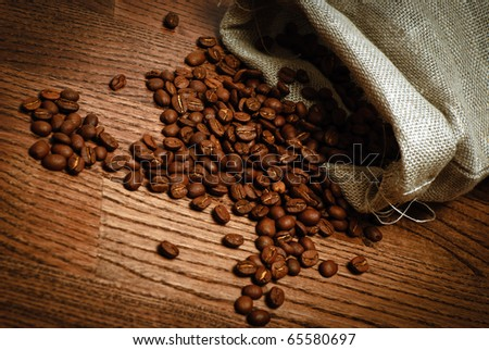 bag of coffee beans scattered on the table