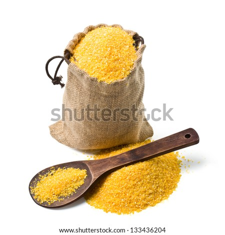 bag of ground corn and a wooden spoon on a white background. keeping paths