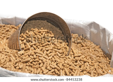 Bag of horse feed with a measuring can