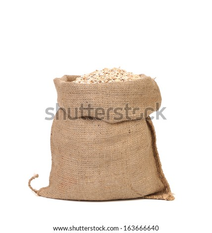 Bag of oatmeal flakes. Close up. Isolated on a white background.