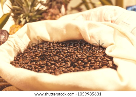 bag of roasted coffee beans on the market in South America. Vintage Toning Effect