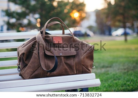 Bag on the bench in autumn park