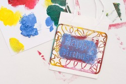 bag stamped with the message of happy birthday. Adhesive stencil.