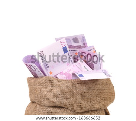 Bag with many euro banknotes. Isolated on a white background.