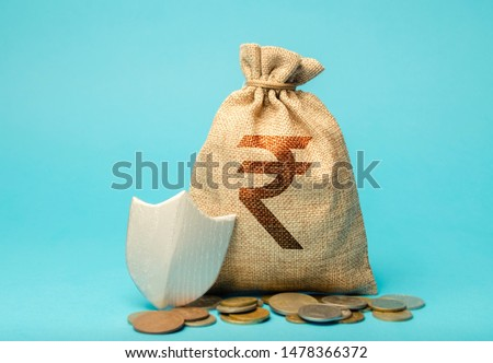 Bag with rupee symbol and protection shield. Concept security of money, guaranteed deposits. Client rights protection. Compensation for losses in inflation, safeguarded investment capital.