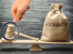 Bag with the word Penalty and gavel on the scales. Penalty as a punishment for a crime and offense. Fraud. The court's decision. Appeal. Cancellation of fines and financial penalties. Litigation