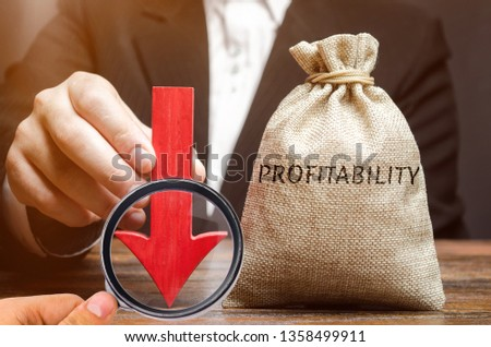Bag with the word Profitability and a down arrow with a businessman. Low economic efficiency and profitableness. Drop in profits and earnings in a company. Unprofitability. Financial instability #1358499911