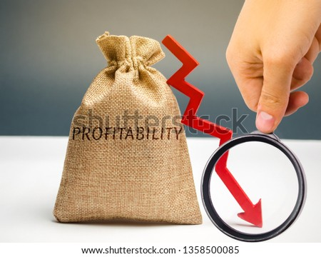 Bag with the word Profitability and a down arrow with a businessman. Low economic efficiency and profitableness. Drop in profits and earnings in a company. Unprofitability. Financial instability #1358500085