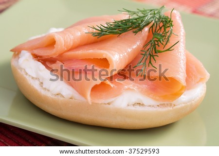 Bagel topped with cream cheese, salmon, and fresh dill.