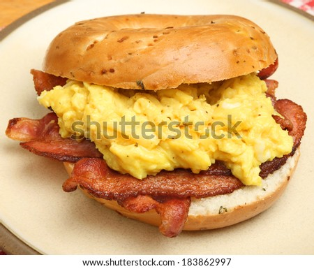 Bagel with bacon and scrambled eggs.