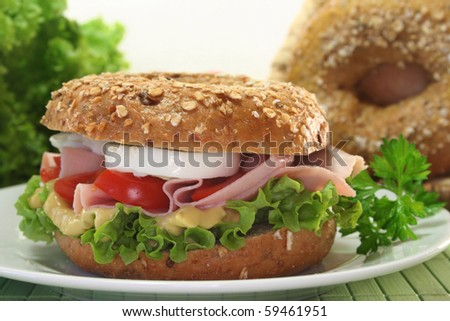 Bagel with boiled ham, tomato and egg