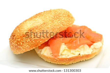 Bagel with smoked salmon and soft cheese  on plate