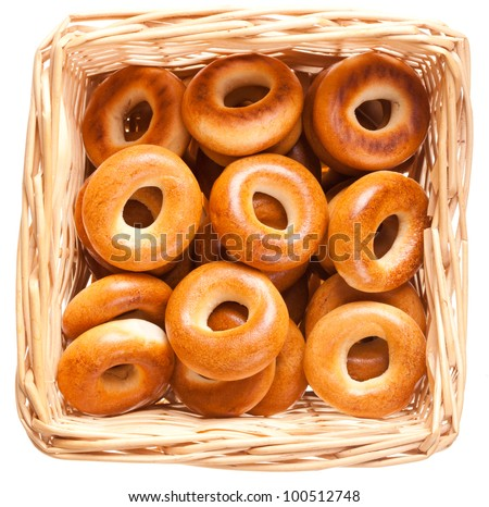 bagels in the basket  isolated over white background