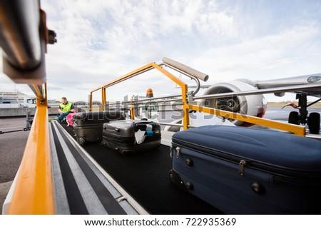 Baggage On Conveyor Belt Being Unloaded