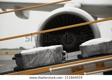Baggage on the conveyor belt to the airplane.