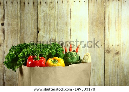 Bagged Grocery Produce Items on a Wooden Plank