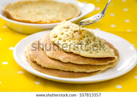 Baghrirs with honey,pancakes with 1000 holes - stock photo